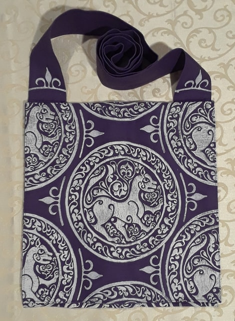 Bag made from purple cotton canvas, lined, printed with a hand carved 11th century middle eastern lioness stamp.