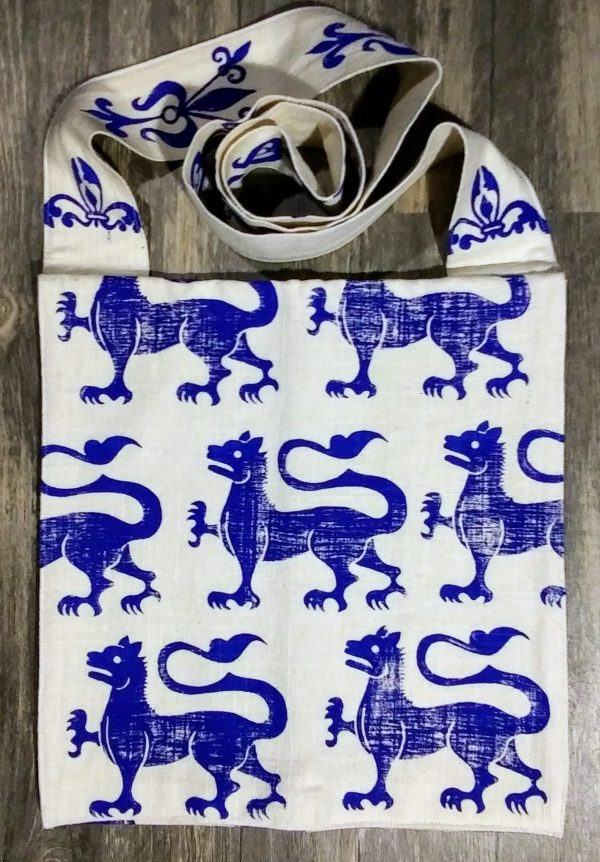 Bag made from white cotton fabric, lined with white cotton fabric & hand printed in blue with a hand carved 13th century dragon stamp.