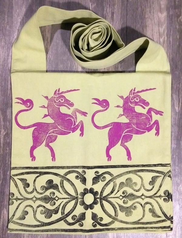 Bag made from green cotton fabric, lined with the same fabric & hand printed in magenta and black with hand carved 14th century unicorn & 13th century decorative border stamp.