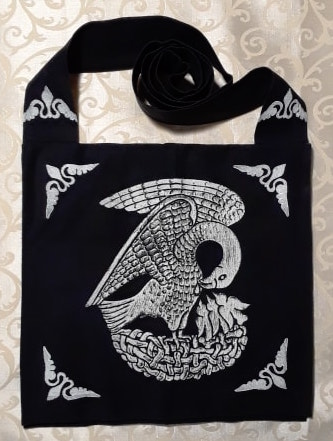 Bag made from black cotton canvas, lined, printed with a hand carved 15th century Pelican stamp