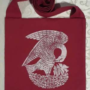 Bag made from red cotton canvas, lined, printed with a hand carved 15th century Pelican stamp in white.