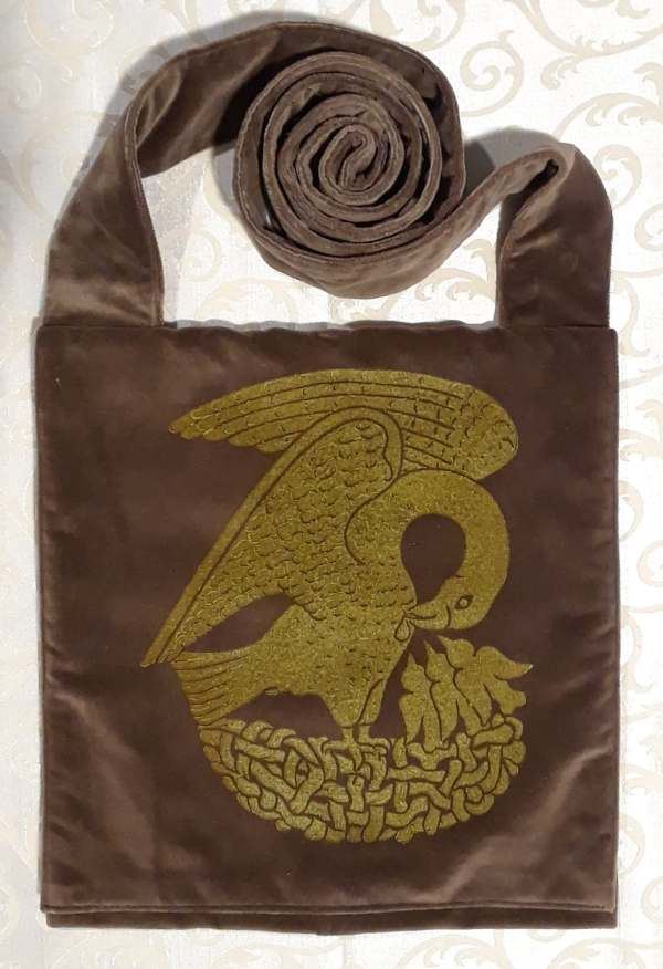 Bag made from brown velvet, lined, printed with a hand carved 15th century Pelican stamp in gold.