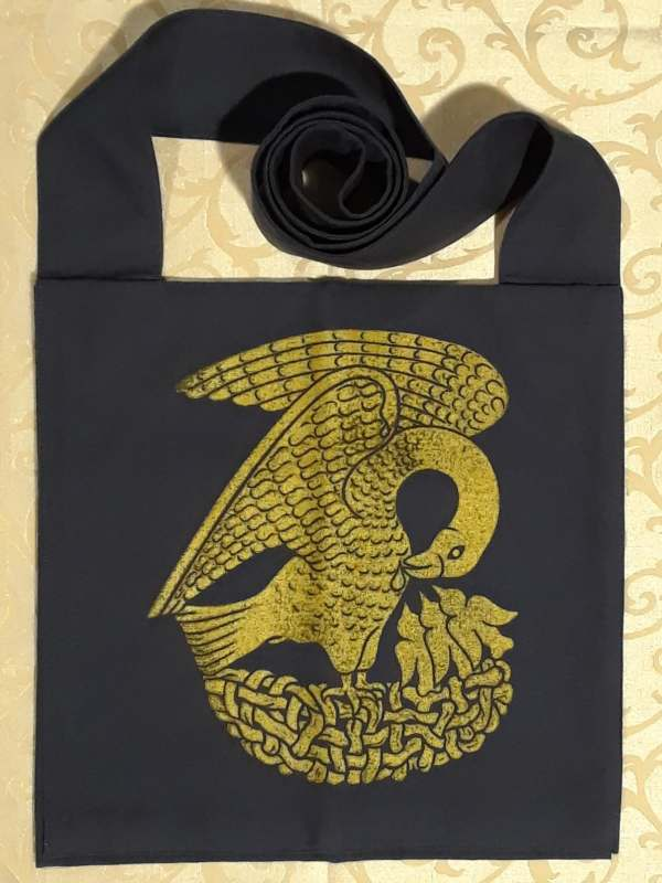 Bag made from blue cotton canvas, lined, printed with a hand carved 15th century Pelican stamp in gold.