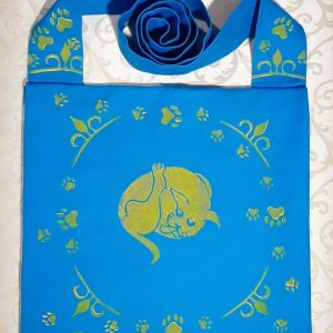 Bag made from turquoise cotton canvas, lined with yellow cotton canvas & printed with hand carved cat & cat paw print stamps.