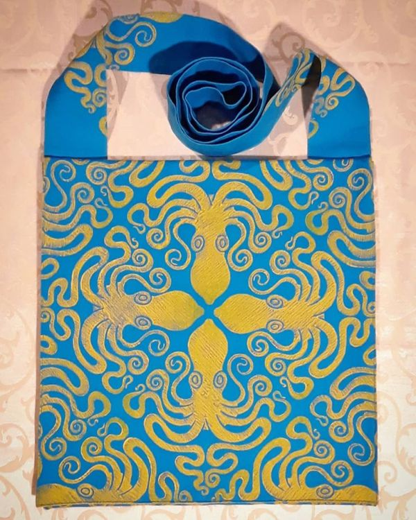 Bag made from turquoise cotton canvas, lined with yellow cotton canvas & printed with a hand carved octopus stamp.