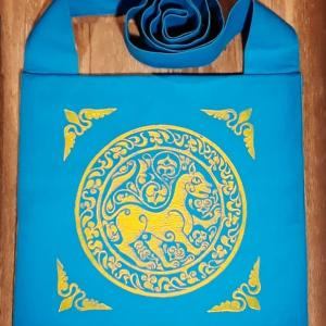 Bag made from turquoise cotton canvas, lined, hand printed with a hand carved 11th century middle eastern lioness stamp.