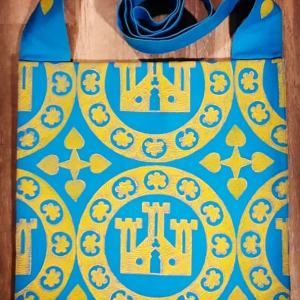 Bag made from turquoise cotton canvas, lined, hand printed with a hand carved 13th century castle roundel print.