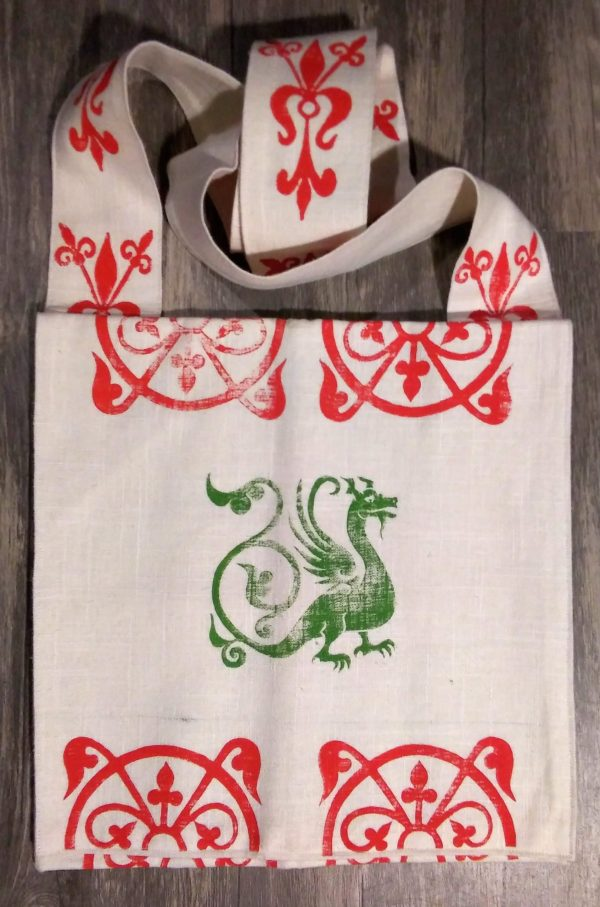 Bag made from white cotton fabric, lined with white cotton fabric & hand printed in red & green with a hand carved 13th century dragon and other medieval inspired stamps.