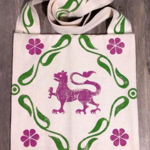 Bag made from white cotton fabric, lined with white cotton fabric & hand printed in magenta with a hand carved 13th century lion stamp.
