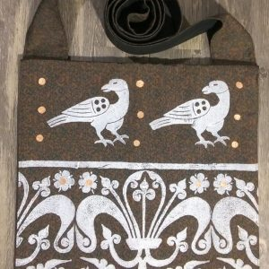 Raven bag made from green & brown patterned fabric, lined with black cotton fabric & hand printed with hand carved 13/14th century raven & 13th century decorative border stamp.