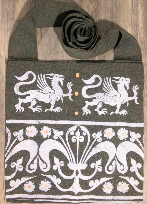 Griffin bag made from green & brown patterned fabric, lined with black cotton fabric & hand printed with a hand carved 13th century griffin & decorative border stamp.