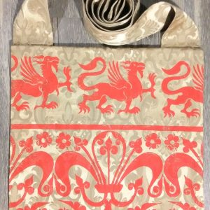 Bag made from lovely gold colored fabric, lined with red cotton fabric & hand printed in red with a hand carved 13th century griffin & decorative border stamp.