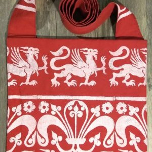 Bag made from red cotton canvas, lined with red cotton fabric & hand printed in white with a hand carved 13th century griffin & decorative border stamp.