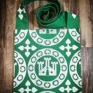 German 13th century castle print bag made from green cotton canvas, lined in white, hand printed with a hand carved 13th century castle roundel stamp.