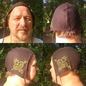 Large linen coif/arming cap made from lovely black linen fabric, handprinted in yellow with a handcut stamp inspired by 12th century goldwork embroidery.