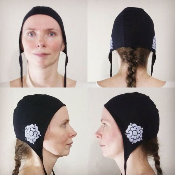 Small black linen coif/arming cap made from black linen fabric, handprinted in white with a handcut medieval inspired rose stamp. Machine washable!