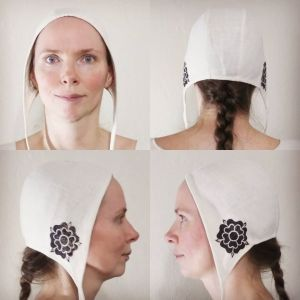 Small white cotton coif/arming cap made from slightly heavier natural white cotton fabric from one of the last American cotton mills, handprinted in black with a handcut medieval inspired rose stamp. Machine washable!