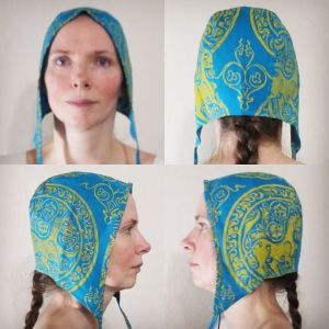 Limited edition medium linen coif/arming cap made from lovely teal linen fabric, handprinted in yellow with a handcut 11th century lioness print & 12th century decorative filling stamp.