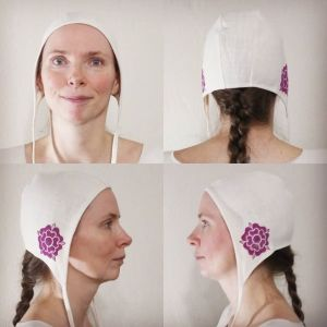 Small white cotton coif/arming cap made from slightly heavier natural white cotton fabric from one of the last American cotton mills, handprinted in magenta with a handcut medieval inspired rose stamp. Machine washable!