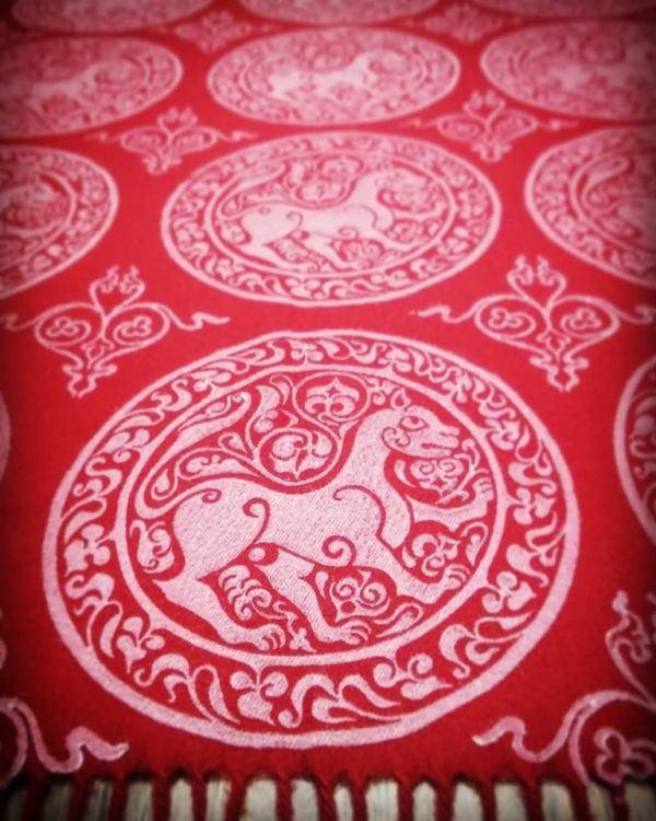 Soft & cozy red scarf with 11th century lioness print & 12th century decorative filling stamp. Hand printed with hand carved stamps. The scarf is new, pre-washed, ready to wear & machine washable!