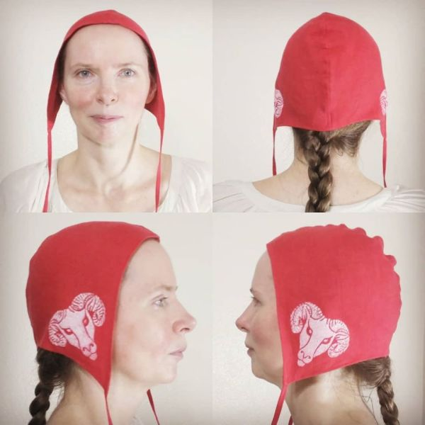 Medium size red linen coif / arming cap made from red linen, printed by hand in white with a handcut ram head stamp. Pre-washed fabric, ready to wear & machine washable!