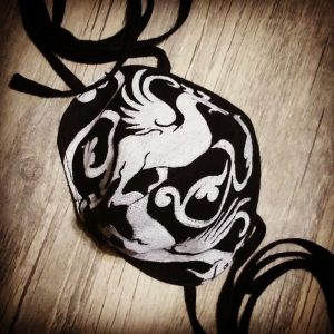 Black linen dragon face mask with extra long ties and white 13th century dragon print. New, pre-washed fabric, ready to wear and machine washable!