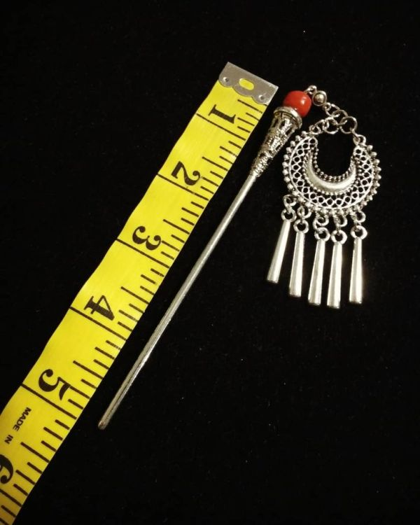 Beautiful metal hair stick in silver color with red glass bead. Has a good weight and a lovely shine - pretty jewelry for your hair!