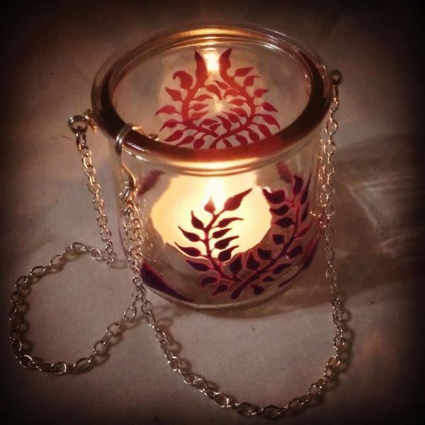 A lovely small upcycled hanging candle holder, made from a yoplait/oui glass jar, painted by hand with purple laurel wreaths & leaves.