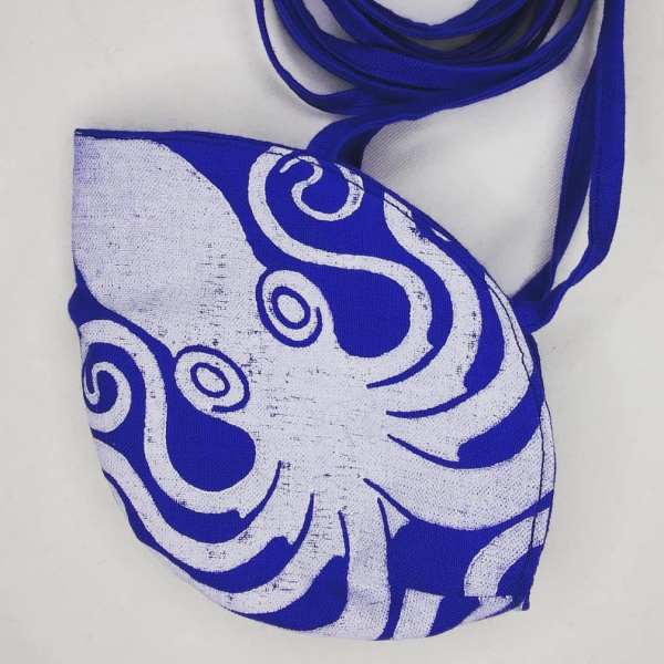 Blue linen octopus face mask with long ties and white octopus print. New, pre-washed fabric, ready to wear and machine washable!