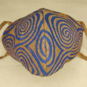 Lovely brown linen neolithic Newgrange triple spiral face mask with long ties and blue triple spiral print. New, pre-washed fabric, ready to wear and machine washable!