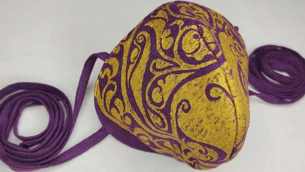 Purple/magenta linen face mask with long ties and premium gold middle eastern inspired11th century lioness print. New, pre-washed fabric, ready to wear and machine washable!