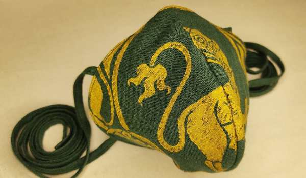 Dark green linen face mask with extra long ties and premium gold 12th century lion print. New, pre-washed linen fabric, ready to wear and machine washable!