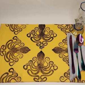 Art for your table in form of a single place mat with octopus print. Hand printed with my own hand carved stamp. The cotton canvas for this place mat is new & pre-washed. It is ready to be used & machine washable!