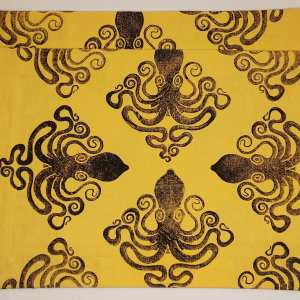 Art for your table in form of a set of 2 yellow place mats with octopus print. Hand printed with my own hand carved stamp. The cotton canvas for the place mats is new & pre-washed. They are ready to be used & machine washable!
