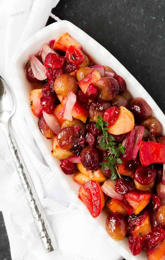 Add this beautiful jewel toned side to your holiday menu!  Cranberry sauce with roasted grapes, apples, and shallots provides a burst of flavor, both sweet and savory, that is unforgettable.