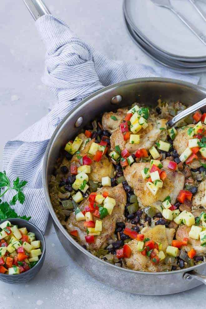 Image of chicken and rice all made in one pan with Cuban flavors.