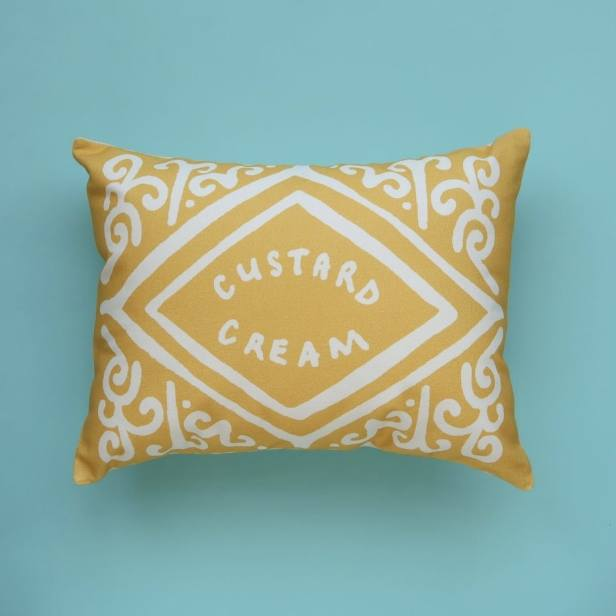 Nikki McWilliams Custard Cream cushion