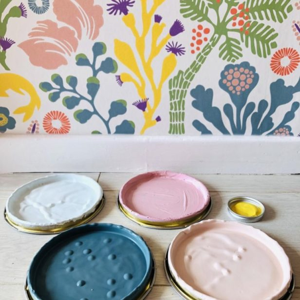 Craig and rose paint tin lids showing colours for hallway