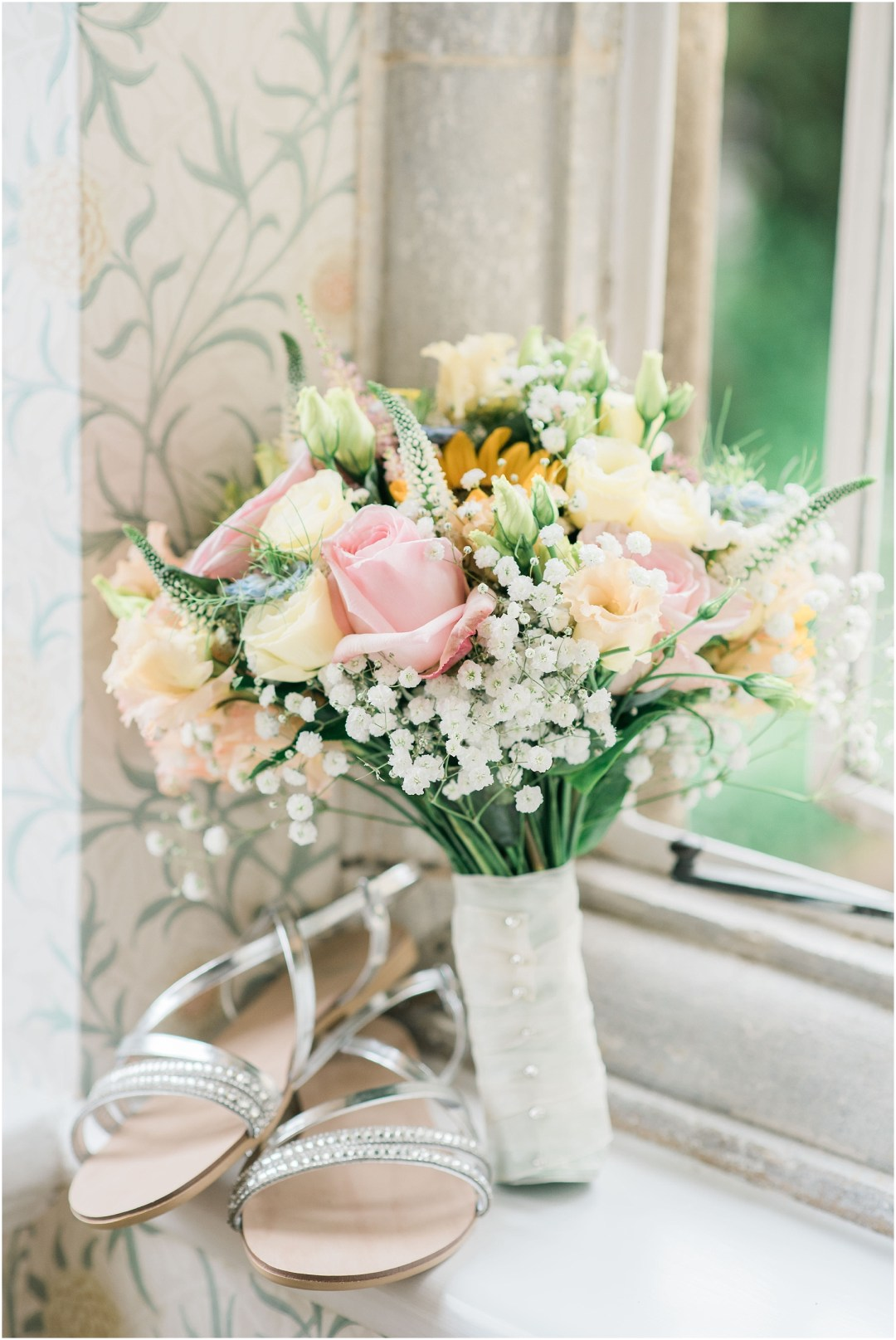 pastel bouquet and bridal shoes on a window sill