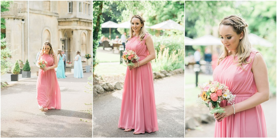 bridesmaid holding floral bouquet wearing pastel pink dress