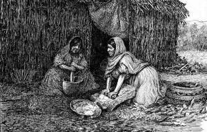 Grinding corn on the metate
