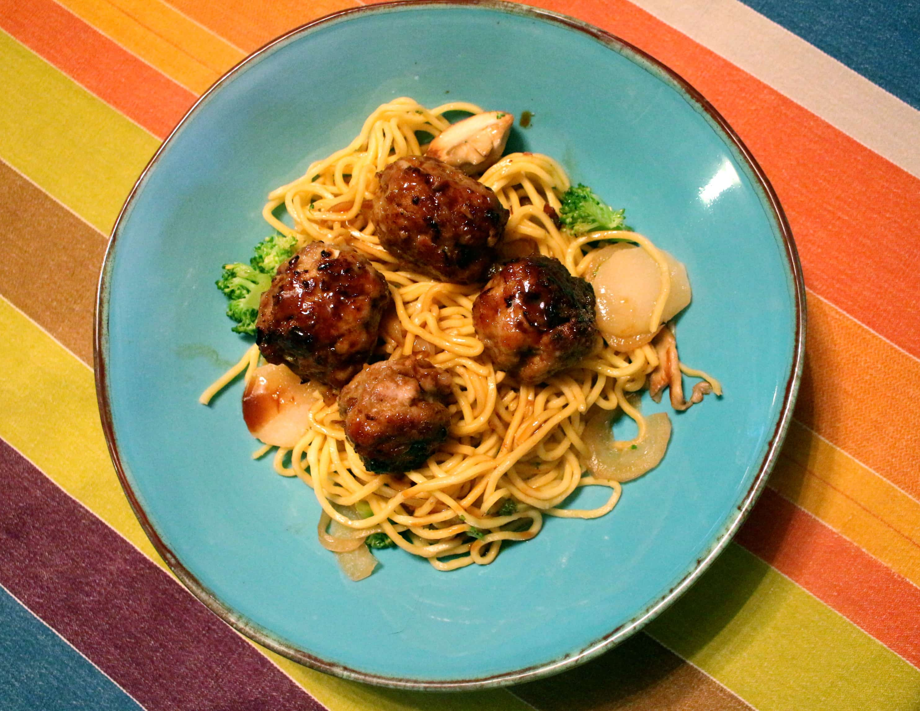 asian meatballs over sesame noodles
