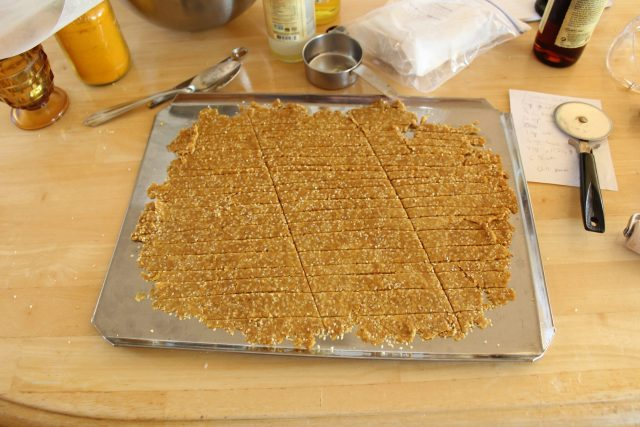 Rolling and cutting sesame sticks.