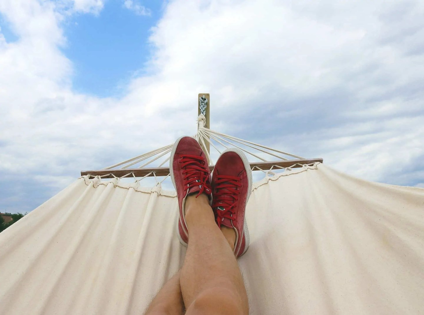 person with feet on hammock
