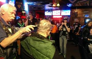 Don Wadewitz gets his hair shaved off for Mitchell School