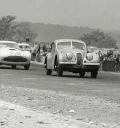 last turn before start finish line at the1953 watkins glen grand prix the 90 jaguar xk 120 of gled derujinski leads the siata of otto linton 58 and  [ 4112 x 1900 Pixel ]