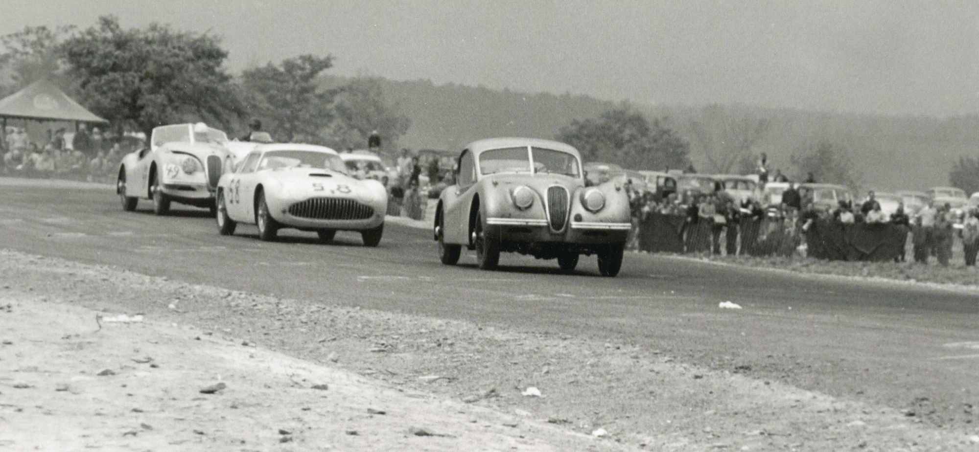 hight resolution of  last turn before start finish line at the1953 watkins glen grand prix the 90 jaguar xk 120 of gled derujinski leads the siata of otto linton 58 and