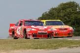 2010_Watkins_Glen_Aug_NSCS_race_Juan_Pablo_Montoya_Marcos_Ambrose_side-by-side