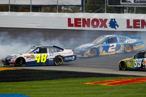 2010_NHMS_Sept_NSCS_Jimmie_Johnson_Kurt_Busch_spin
