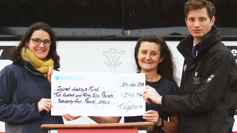 Tina from Lingfield presenting £545 to the IJF